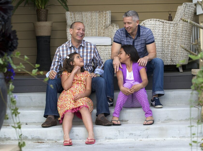 Jonathan Bailey (top left), his partner Triton Klugh (top right) and daughters Sophia (bottom right)  and Ava (bottom left) in their Mission Hills home.