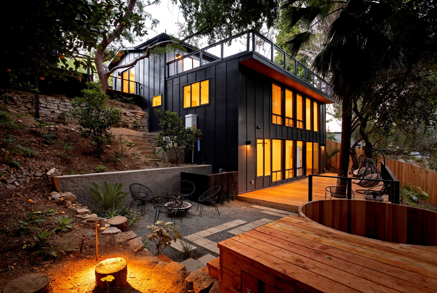 Listed for $2.149 million, the renovated home in Mount Washington presents as a modern treehouse with expansive decking that incorporates a number of mature trees into its design. Renovated by L.A.-based firm KeltnerCo, the three-bedroom, four-bathroom house has a casual feel with open-concept living areas, light hardwood floors and a mostly white-walled interior. The new-look kitchen is anchored by an island/breakfast bar topped with dark-hued Calacatta marble. The living room, which has a three-sided fireplace, sits nearby. Decking on multiple levels creates more than 700 square feet of additional space. A detached studio and a cedar spa lie elsewhere on the grounds.