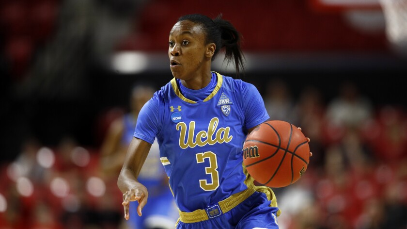UCLA guard Kiara Jefferson drives in the first half against Maryland.