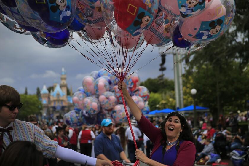 Stephanie Gwinn of Norco enjoys the scene at Disneyland during the theme park's Diamond Celebration.