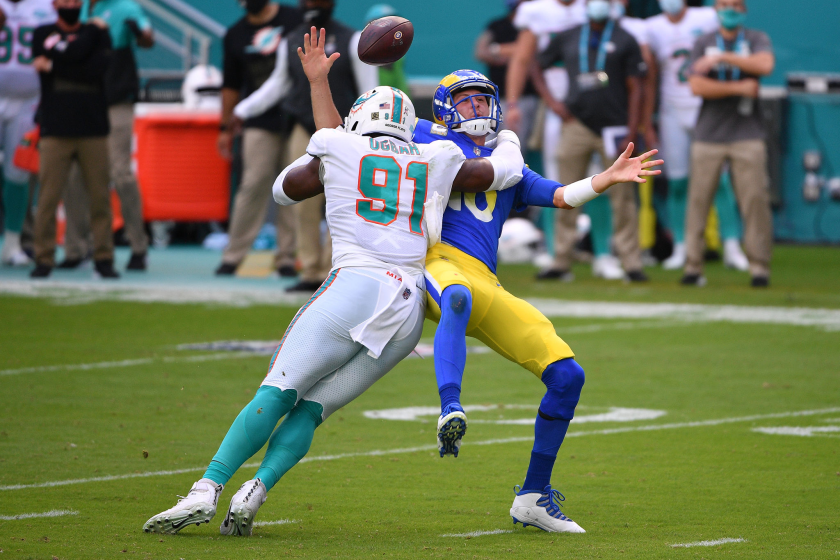 Rams quarterback Jared Goff fumbles the ball as he is hit by Miami's Emmanuel Ogbah.