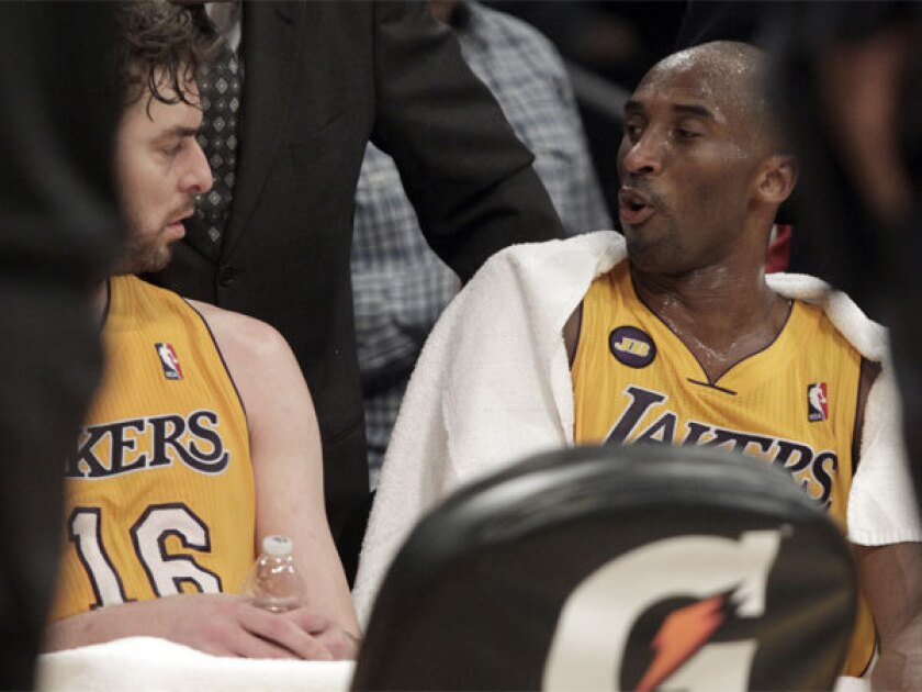 Pau Gasol, left, and Kobe Bryant talk during a timeout Tuesday night at Staples Center.