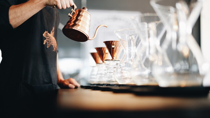 A barista at Fika Co. sets up pourover coffee.