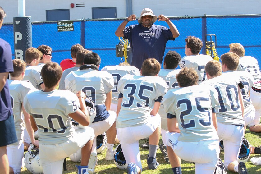 Flintridge Prep football coach Russell White talks about the importance of the commitment to the Rebels during a recent preseason practice.