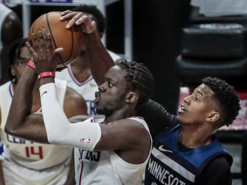 Minnesota Timberwolves guard Jarrett Culver blocks the shot of Clippers guard Reggie Jackson.