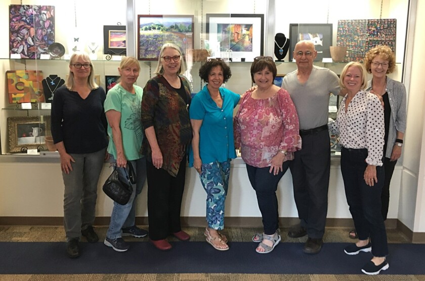 SDAG members Jill Ballard, Nora Dewey, Grace Swanson, Cheryl Ehlers, Karen Fidel, Cam Baher, Diane O'Connell, and Cheryl DeLain installed the show at the Encinitas Community Center. Missing are Gayle Baker, Jeffrey R. Brosbe, Debi Buffington, Kathy Bush, Sharon Hoffman, Nancy Atherton-West, and Linda Melemed