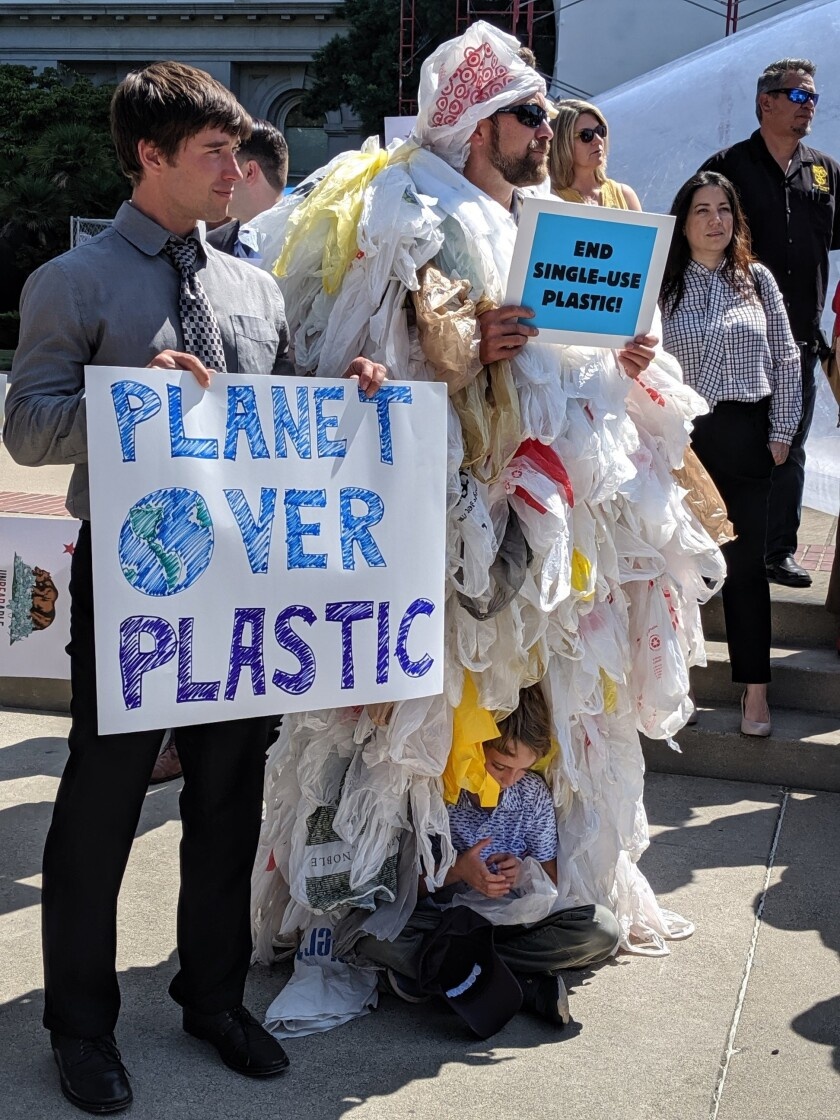 Oceana's Brady Bradshaw and Geoff Shester attended an Aug. 21 rally to support a bill designed to reduce plastic pollution.