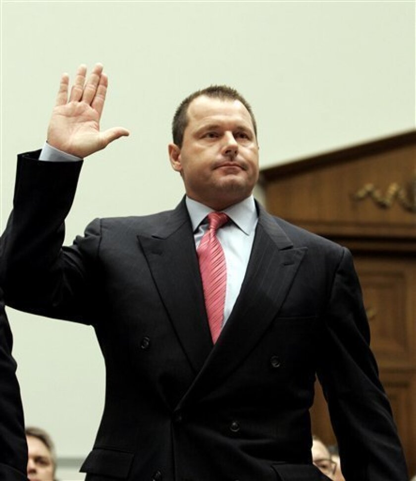 This Feb. 13, 2008 file photo shows former New York Yankees baseball pitcher Roger Clemens being sworn-in on Capitol Hill in Washington, prior to testifying before the House Oversight, and Government Reform committee hearing on drug use in baseball. (AP Photo/Susan Walsh, File)