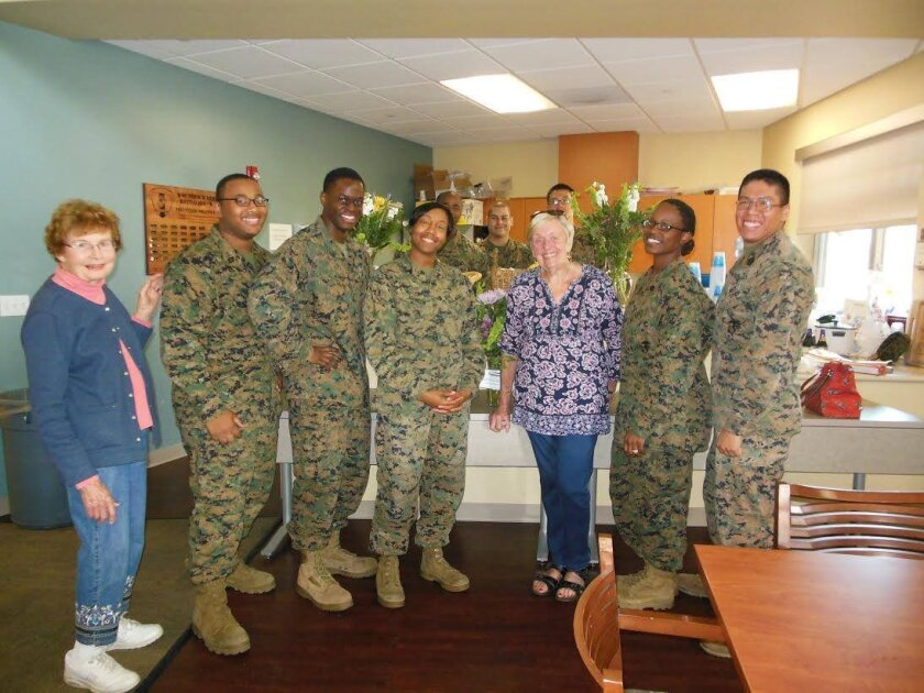 Garden Club members LaVerne Schlosser (left) and Shirley Corless (middle), with Marines who care for troops in the Wounded Warriors program.