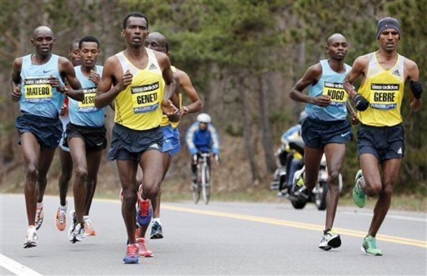 Elite mens marathoners, from left, Levy Matebo, Lelisa Benti, Markos Geneti, Micah Kogo and Gebregziabher Gebremariam compete on the Boston Marathon course in Wellesley, Mass., Monday, April 15, 2013. (AP Photo/Michael Dwyer)