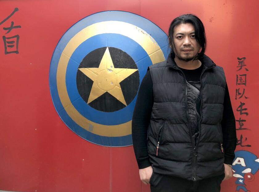 BEIJING CHINA NOVEMBER 21, 2018 -- Geng Shuai with his Captain America theme screen, the shield is m