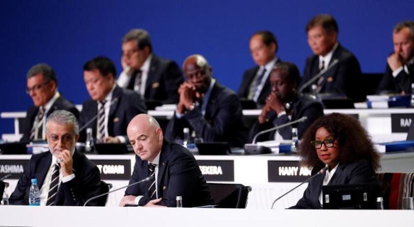 FIFA president Gianni Infantino (C), Salman Bin Ibrahim Al-Khalifa, President of the Asian Football Confederation and FIFA general secretary Fatma Samba Diouf Samoura (R) at the start of the 68th FIFA Congress in Moscow, Russia. EFE