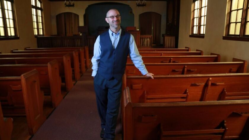 Jeff Zlotnik, standing inside the vacant Swedenborgian Church in University Heights, is adviser to a Buddhist fraternity at San Diego State University. The fraternity may expand to other schools, and the Buddhist temple Zlotnik co-founded is in escrow to purchase the church.