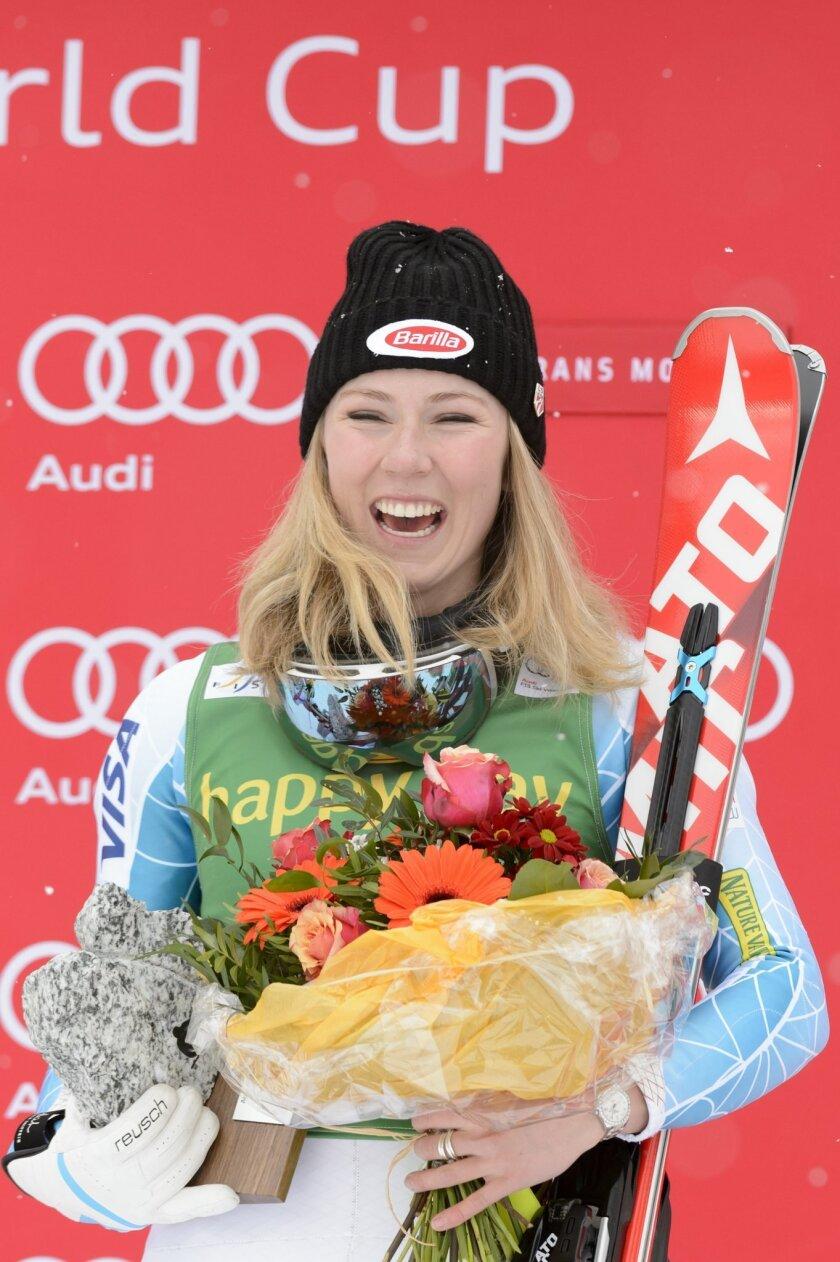 Mikaela Shiffrin of  the U.S.  celebrates during the podium ceremony after winning the women's Slalom race at  the FIS Alpine Ski World Cup in Crans-Montana, Switzerland, Monday, Feb.  15, 2016. (Laurent Gillieron/Keystone via AP)