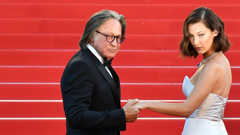 Mohamed Hadid and daughter Bella Hadid pose before a film screening in May at the Cannes Film Festiv