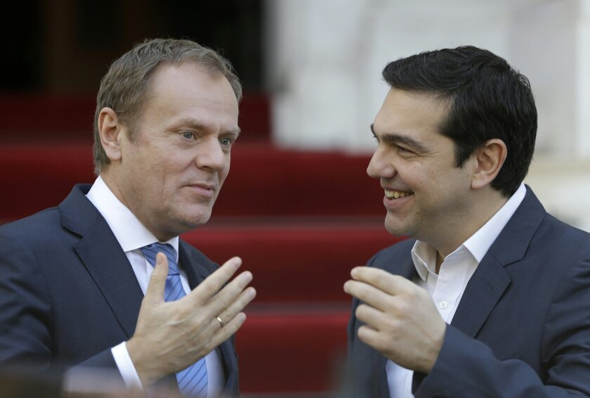 Greece's Prime Minister Alexis Tsipras, right, welcomes European Council President Donald Tusk at Maximos Mansion in Athens Tuesday, Feb. 16, 2016. After decades of often unbridled expansion and increasing prosperity, the once-robust European Union is this week looking at its biggest challenge - cr