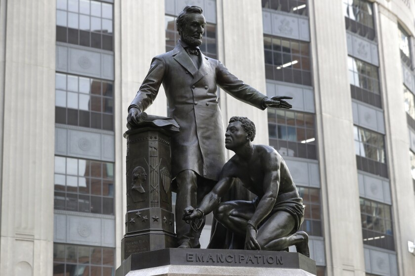 Statue of slave kneeling at Abraham Lincoln's feet