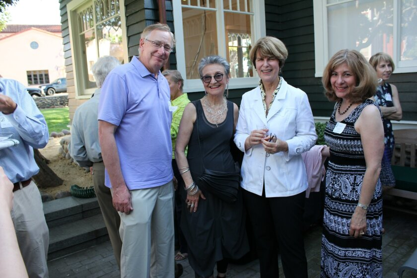 Historic La Jolla home owners Bob Agdern, architect Reena Racki, LJHS board vice-president Seonaid McArthur and Barbara Agdern celebrate 'La Jolla Landmarks Day.' The Agderns live in a 1936 home designed by architect Cliff May (father of the California Ranch House); Racki lives in one of the homes