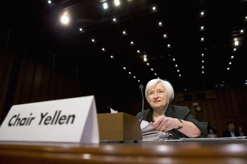 FILE - In this Thursday, Dec. 3, 2015, file photo, Federal Reserve Chair Janet Yellen prepares to testify on Capitol Hill in Washington, before the Joint Economic Committee. The Federal Reserve raised its key interest rate in mid-December from record lows and signaled the likelihood of four more hi