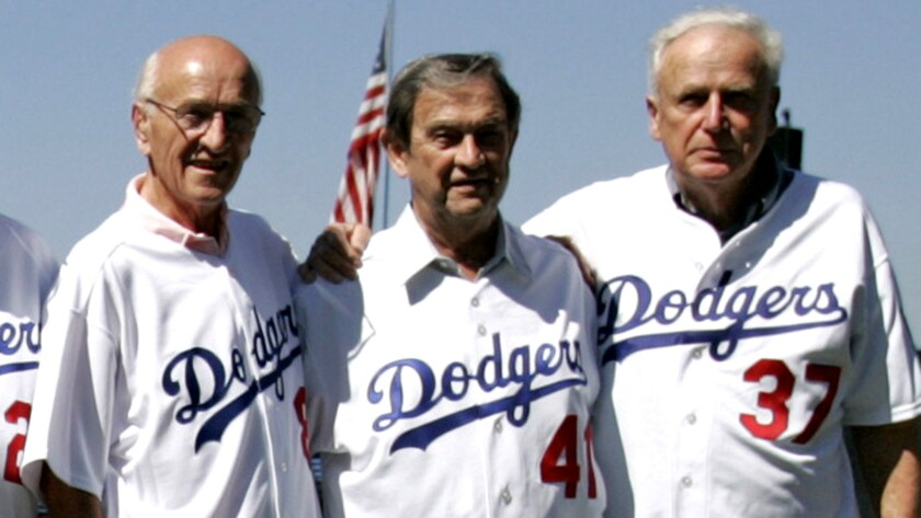 Ed Roebuck. right, poses with other members of the Dodgers' 1955 championship team including George Shuba, left, and Clem Labine at a Dodgers Stadium reunion in 2005.