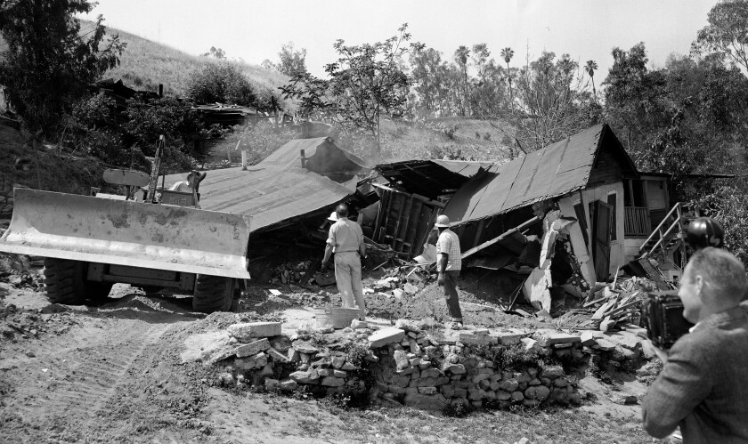May 8, 1959: A bulldozer razes the Arechigas family home  orcibly removed.