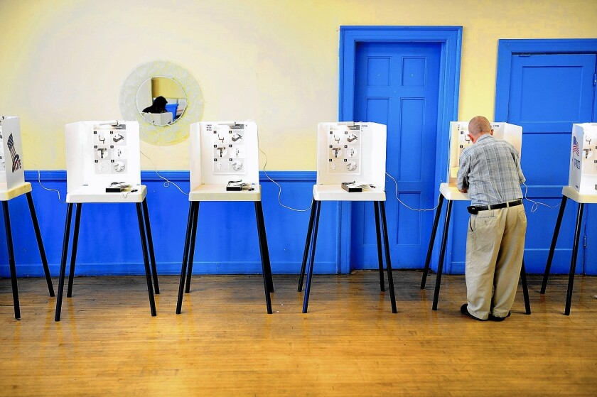 A man votes at St. Anthony Grand Lodge in South Los Angeles.