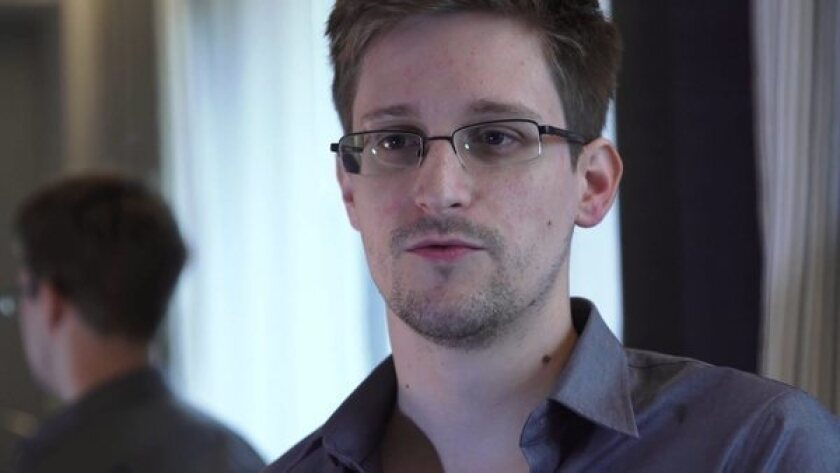 A video grab courtesy of the Guardian newspaper shows former CIA employee Edward J. Snowden during an exclusive interview with the newspaper's Glenn Greenwald and Laura Poitras in Hong Kong. During the interview, he revealed himself as the source of documents outlinig a massive effort by the National Security Agency to track cellphone calls and monitor email and Internet traffic.