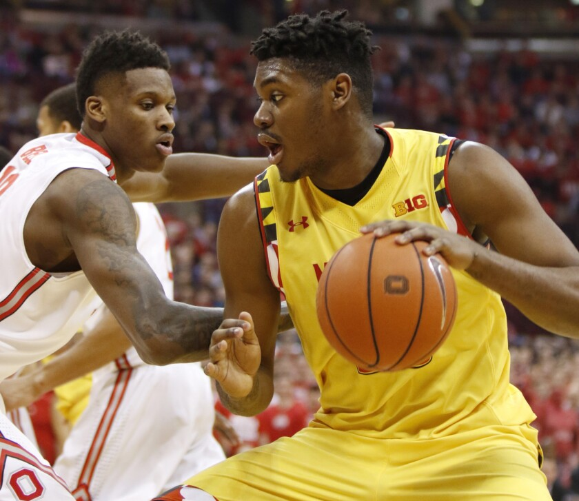 No. 8 Maryland prevails over host Ohio State, 66-61