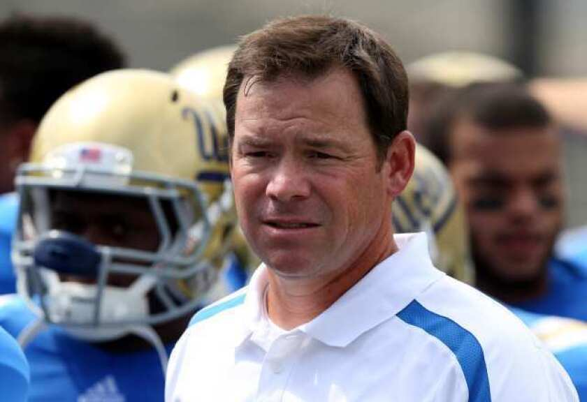 """UCLA's football team has begun practicing at 7 a.m. """"They get up and we have their full attention,"""" Coach Jim Mora says of the new schedule."""