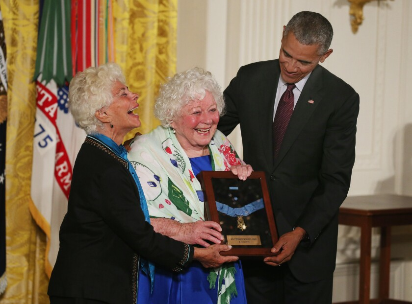 President Obama presents the Medal of Honor to Elsie Shemin-Roth, center, and Ina Bass, accepting on behalf of their late father, Army Sgt. William Shemin, for his actions during World War I. Obama also awarded a Medal of Honor to the late Army Pvt. Henry Johnson.