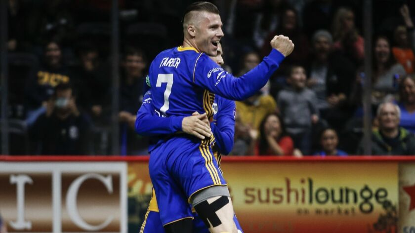San Diego Sockers midfielder Brian Farber (7) celebrates his first quarter goal against Tacoma.