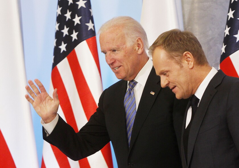 Vice President Joe Biden, left, and Poland's Prime Minister Donald Tusk head for talks Tuesday in Warsaw on Eastern Europe's security.