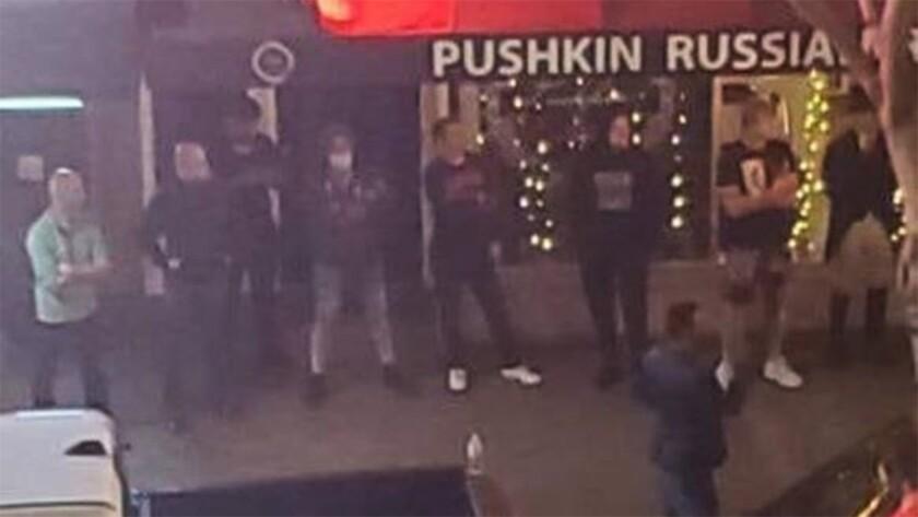 Gazaryan's friends stand guard outside Pushkin Russian Restaurant (c)