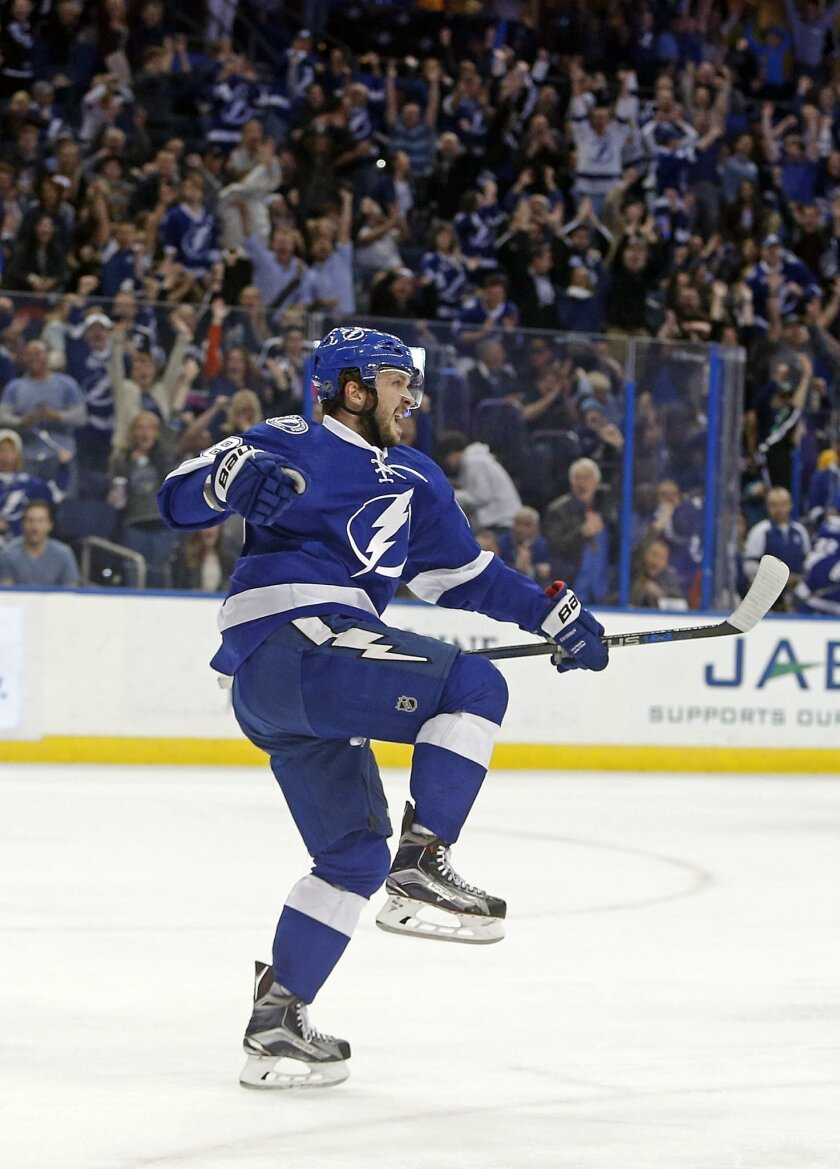 Tampa Bay Lightning right wing Nikita Kucherov (86), of Russia, celebrates his goal during the second period of an NHL hockey game against the Nashville Predators, Friday, Feb. 12, 2016, in Tampa, Fla. (AP Photo/Brian Blanco)