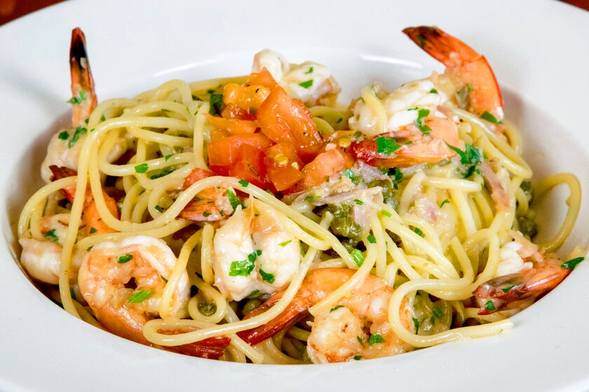 Spaghetti scampi with sautéed shrimp, garlic, shallots, capers and lemon wine butter sauce at Allegra California Café