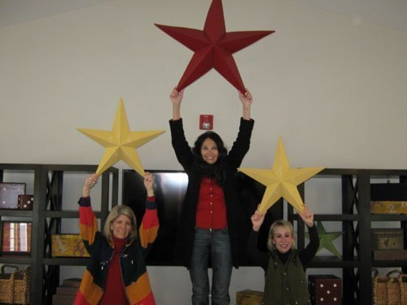 Mary Kay Zolezzi, Teri Summerhays and Vicki Minteer who helped design and coordinate the Girls' Recreational Room at San Pasqual Academy.