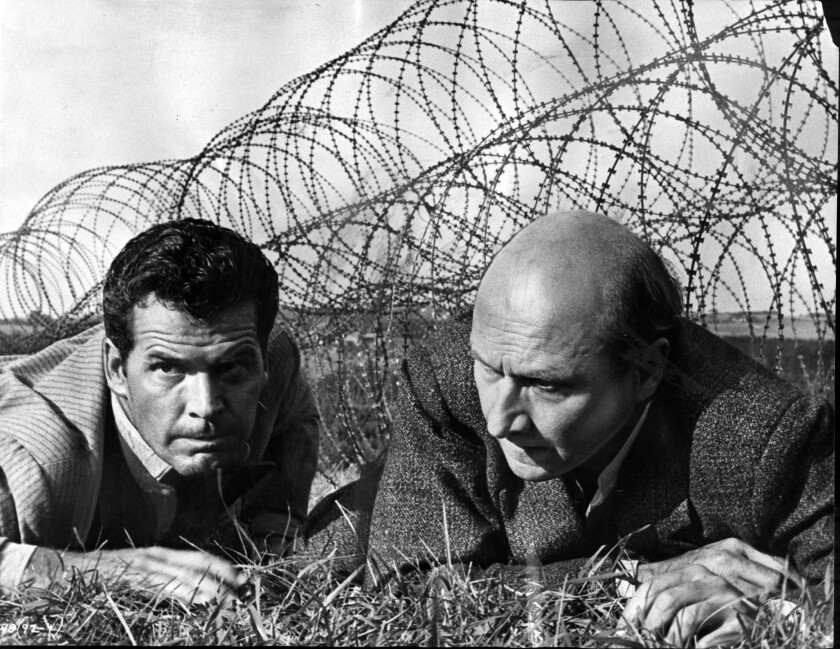 "James Garner, left, and Donald Pleasence in ""The Great Escape"" (1963)."