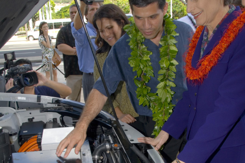 Shai Agassi, founder and then-CEO of Better Place, shows the electric components under the hood of a converted Nissan Rogue to Hawaii Gov. Linda Lingle in Honolulu.