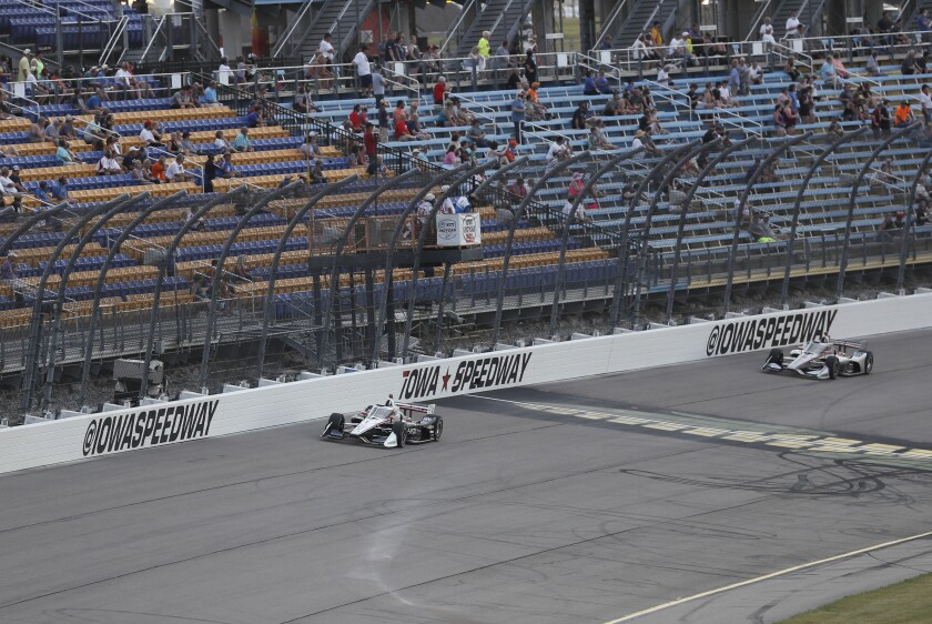 Josef Newgarden leads Will Power, of Australia, right, during the IndyCar Series auto race, Saturday, July 18, 2020, at Iowa Speedway in Newton, Iowa. (AP Photo/Charlie Neibergall)