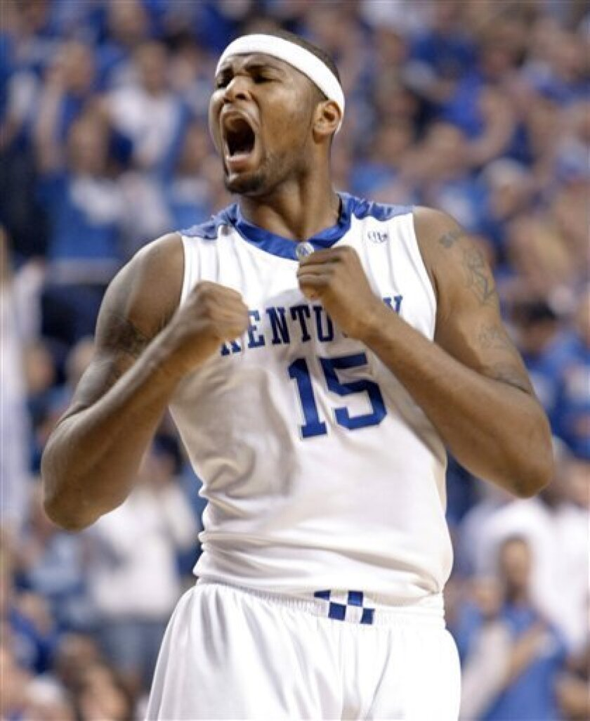 Kentucky's DeMarcus Cousins yells after scoring a basket during the first half of an NCAA college basketball game against North Carolina in Lexington, Ky., Saturday, Dec. 5, 2009. (AP Photo/Ed Reinke)