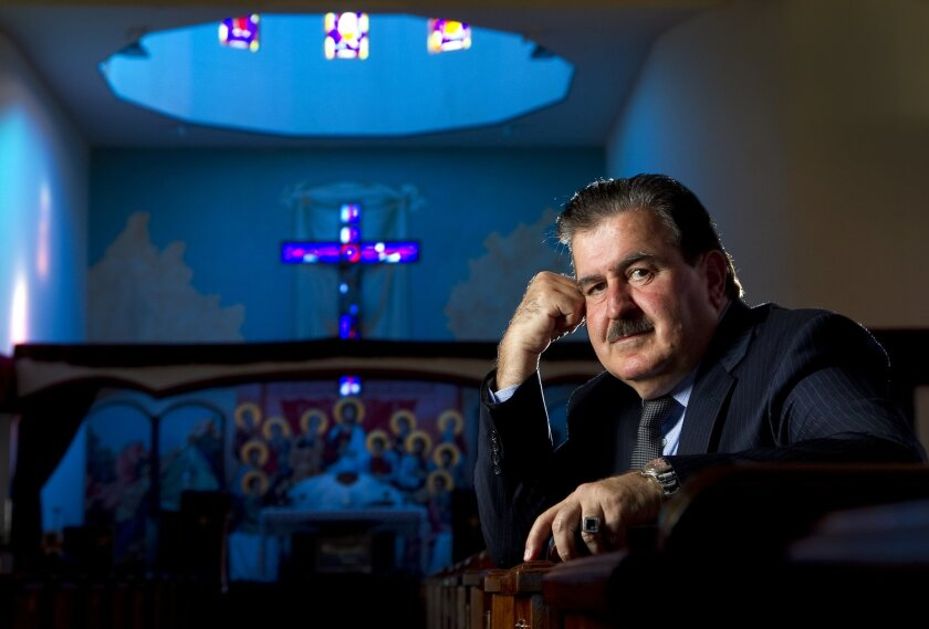Noori Barka, Ph.D, President of the Chaldean American Institute, discusses Chaldeans in San Diego on the 10th anniversary of the Iraq War during a visit to St. Peters Chaldean Catholic Cathedral.