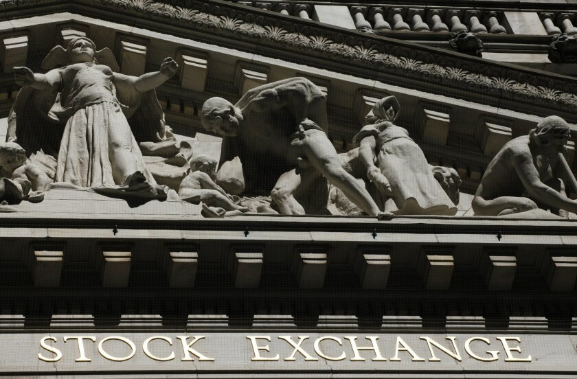 FILE - This July 15, 2013 file photo shows the New York Stock Exchange in New York. Stocks moved slightly lower in early trading Wednesday, June 4, 2014, after a private jobs report suggested that U.S. employers pulled back on hiring last month. (AP Photo/Mark Lennihan, File)