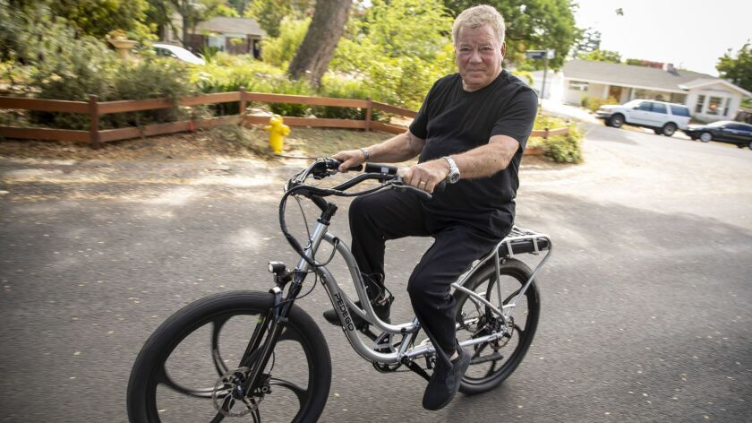 Shatner says he relies on horseback riding and cycling, including this e-bike, to maintain balance and stay fit.