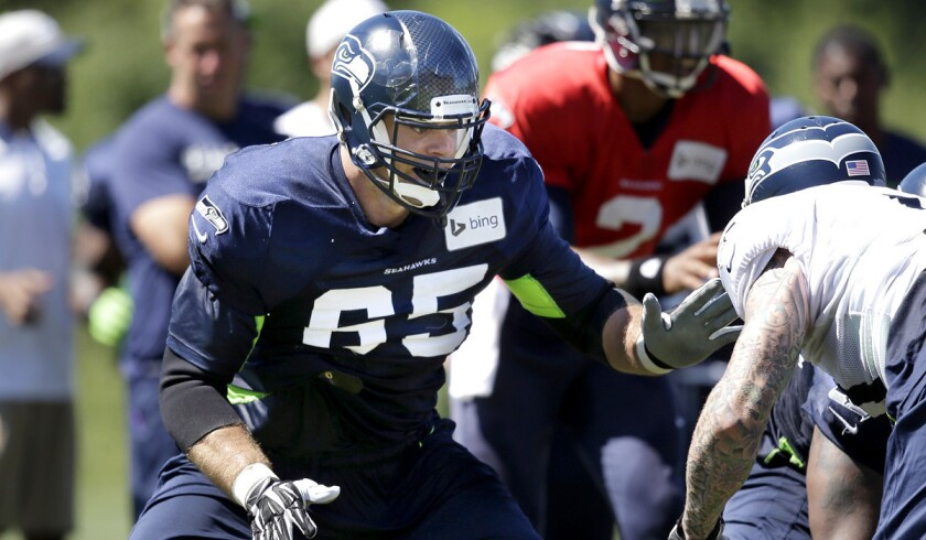 NFLPA President Eric Winston, who was cut in late August, takes part in a Seahawks scrimmage during summer camp.