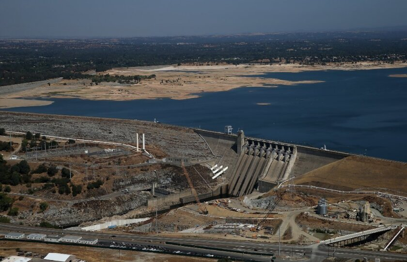 Folsom Lake's low water level can be seen behind the Folsom Dam in a photo taken Aug. 19.