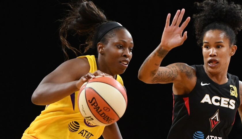 Sparks guard Chelsea Gray drives past Aces forward Tamera Young during a game last season.