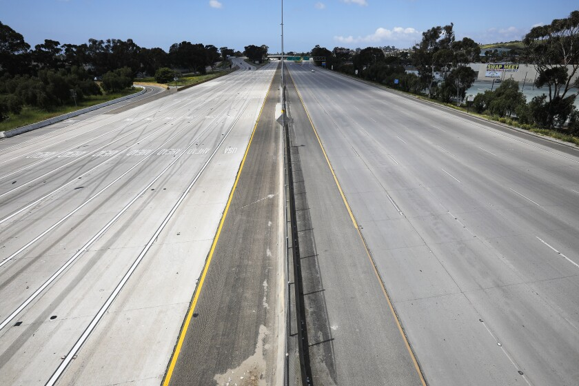 Hardly a car in sight on Interstate 5 near Interstate 805 in San Ysidro on March 29.