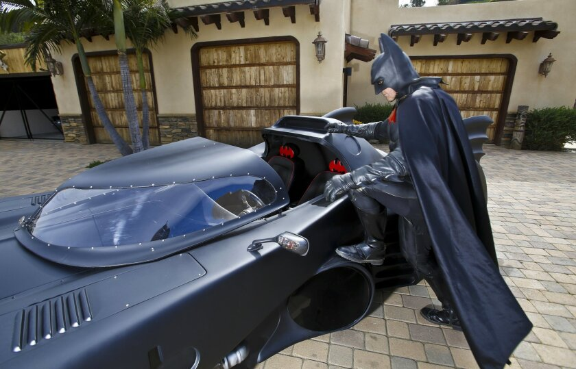 Valley Center businessman Chris Banner has a lifelong obsession with Batman. He owns two souped-up Batmobiles and has several Batman costumes and he frequently dresses up as Batman and patrols the neighborhood. He also does appearances as Batman for charity events. Photo by Don Boomer