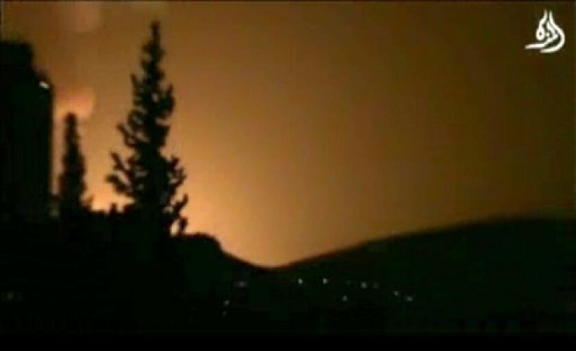 In this image taken from video obtained from Shaam News Network, which has been authenticated based on its contents and other AP reporting, smoke and fire fill the skyline over Damascus, Syria, early Sunday, May 5, 2013 after an Israeli airstrike. Israeli warplanes struck areas in and around the Syrian capital Sunday, setting off a series of explosions as they targeted a shipment of highly accurate, Iranian-made guided missiles believed to be on their way to Lebanon's Hezbollah militant group, o