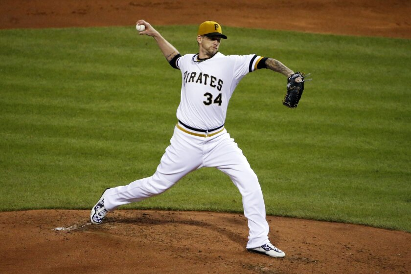 Pittsburgh Pirates starting pitcher A.J. Burnett delivers during the third inning of a baseball game against the Chicago Cubs in Pittsburgh, Wednesday, Sept. 16, 2015. (AP Photo/Gene J. Puskar)